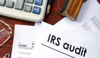 IRS audit title on a document and 1040 form.