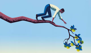 Image of a man on a bending limb reaching for some leaves