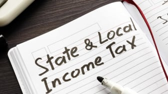 Picture of State Income Tax Written On Pad