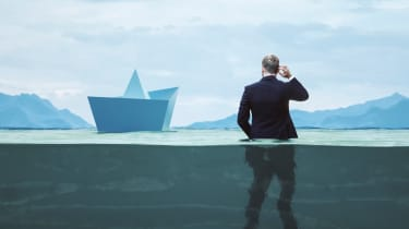 Illustrations shows a businessman standing half submerged next to a ship.