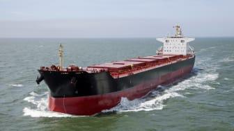 Container ship sailing on calm sea