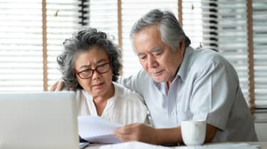 Couple looking at a computer