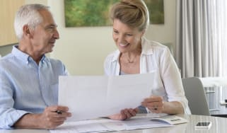 Senior couple doing paperwork at home