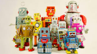 A collection of antique aluminum robots.