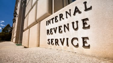 "picture of sign saying ""Internal Revenue Service"" on IRS building"