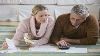 Senior couple going over paperwork for retirement