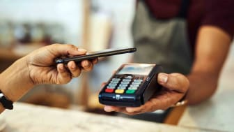someone paying with electronic payment app