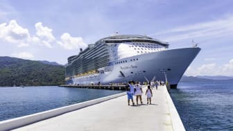 Labadee, Haiti - October 9, 2012: Passengers disembark the Royal Caribbean Cruise ship the Allure of the Seas for a day of beach activities. With a passenger capacity of over 8 thousand, the