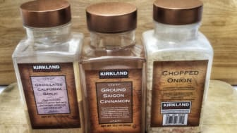 Three large containers of Costco's Kirkland Signature spices