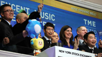 NEW YORK, NEW YORK - DECEMBER 12: Cussion Kar Shun Pang, CEO of Tencent Music Entertainment, (center) rings the opening bell of the New York Stock Exchange (NYSE) as the Chinese music-streami