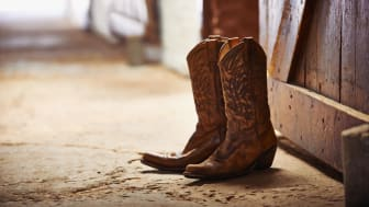 Shot of a pair of cowboy boots in a barn