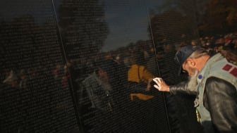 photo of veteran at Vietnam Veterans Memorial