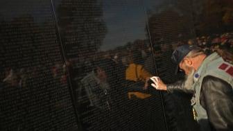photo of veteran at Vietnam Veterans Memorial