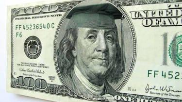Benjamin Franklin wears a mortar board cap.