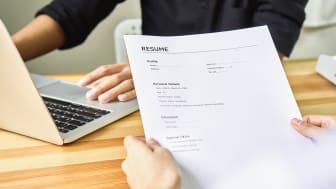 Two people working on a resume