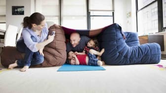 Family playing in blanket fort