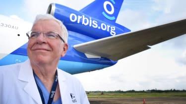 Dr. Lee Alward stands in front of an Orbis International jet.
