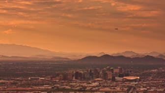 I went up to the top of South Mountain yesterday in hopes of catching some good sunset shots over Phoenix. This was before the light was great, but I still like it with the plane.