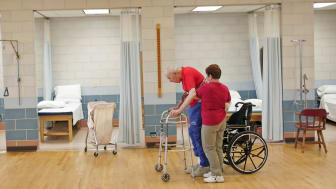 QUINCY, IL - FEBRUARY 17:Shirley Gooding, a physical Therapy Aid, helps William Rexroat, a WWII Navy veteran exercise during a physical therapy session at the Quincy Veterans Home February 17