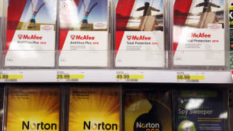 COLMA, CA - AUGUST 19: Boxes of McAfee security software are displayed alongside Norton Anti-virus software by Symantec on a shelf at a Target store August 19, 2010 in Colma, California. Inte