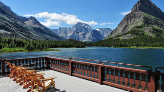 A pier on a lake with mountains in the background