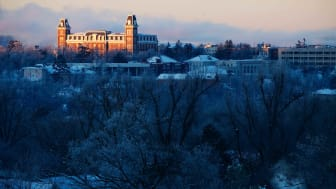 Old Main in the morning light after a snow fall on the campus of the University of Arkansas