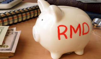 Piggy bank with RMD written on it