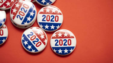 Stars-and-stripes-adorned 2020 election buttons against a bright red background