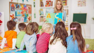 picture of nursery school teacher with preschool children