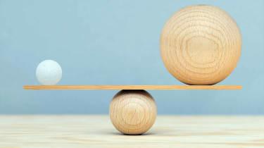 medium-sized ball balancing a small and a large ball