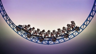 Low-angle view of a roller coaster dip