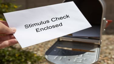 picture of stimulus check enveloped taken out of mailbox