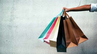 closeup of person holding shopping bags