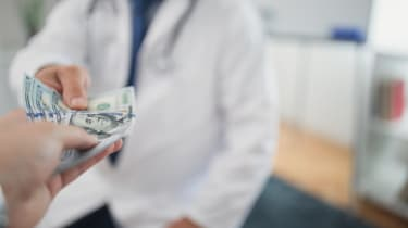 A person paying a doctor