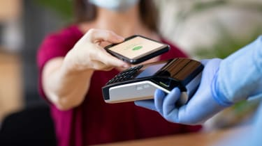 Photo of person paying with phone app