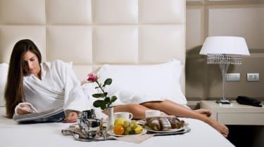 Relaxed Woman Having Breakfast in Bed