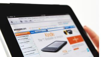 Woman Holding an iPad Displaying Amazon.com Web Site.