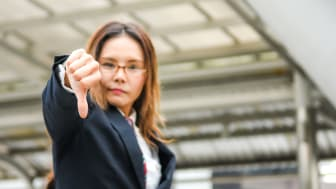 picture of woman giving thumbs down sign