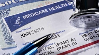 Medicare and social security cards with a stethoscope and pen