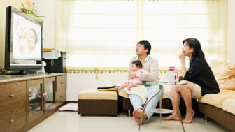 Family watching TV in their living room