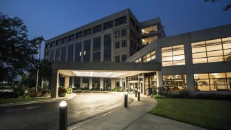 A medical facility is shown at nighttime