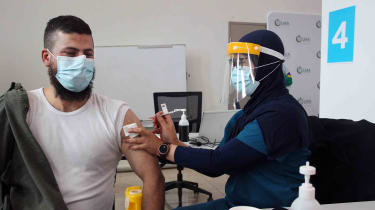 Registered Nurse Ririn Widiashi administers a Pfizer vaccine to a client at the Lebanese Muslim Association in Lakemba on Aug. 8, 2021, in Sydney, Australia.