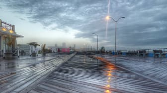 A rainy scene at a boardwalk