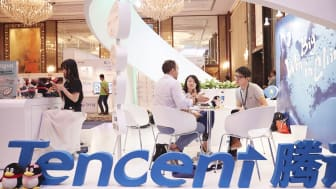 SINGAPORE - MARCH 15: Visitors and exhibitors network at the Tencent booth during the Sportel Asia Conference on March 15, 2016 in Singapore.(Photo by Sean Lee/Getty Images for Sportel)