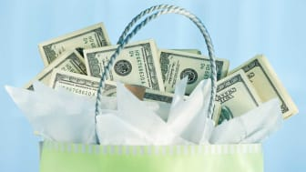 picture of gift bag full of cash