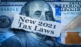 """picture of a one-hundred dollar bill with a note on it that says """"new 2021 tax laws"""""""