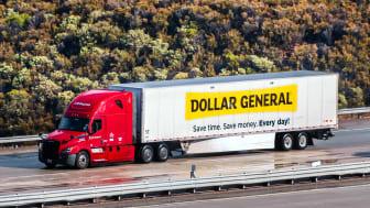 A Dollar General truck drives along a highway