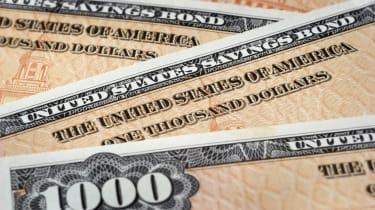 Close up photograph of U.S. Savings Bonds, selective focus.