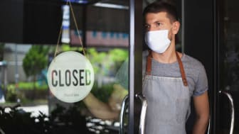 Photo of man with closed shop