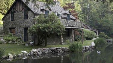 Cottage house on edge of lake